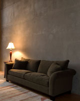 brown couch, end table, and table lamp