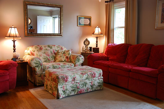 traditional living room couch with oversized chair and ottoman